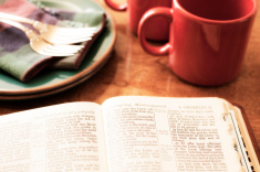 stock-photo-44161760-open-bible-and-morning-coffee-on-breakfast-table